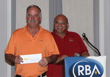 T. Burke took three prizes during the drawing including Men's Longest Drive